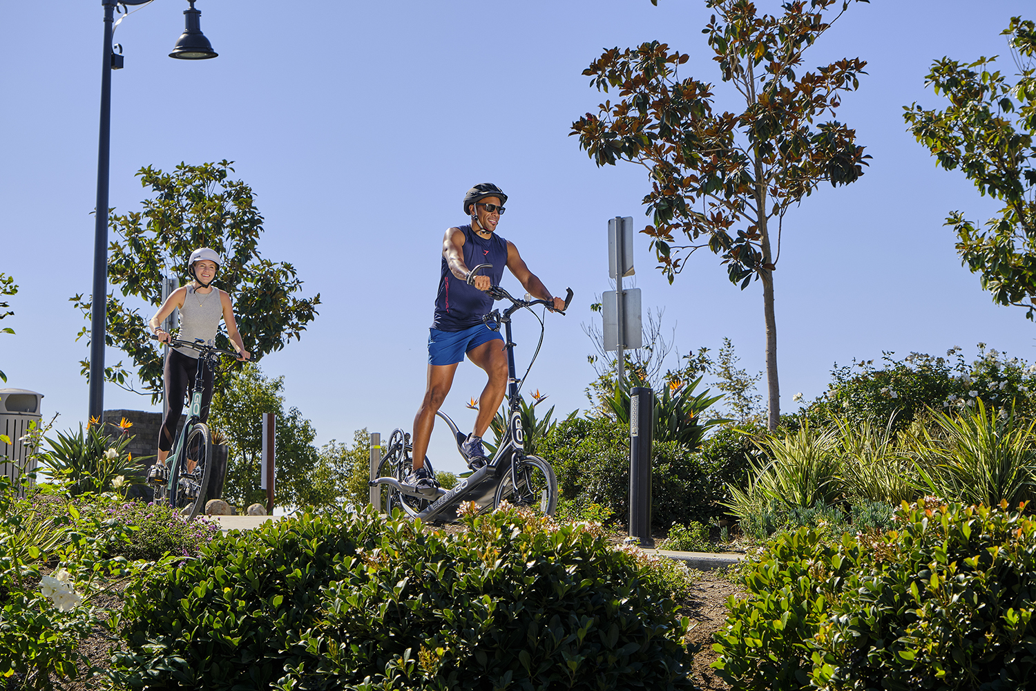 Two ElliptiGO riders, a girl on RSUB and a male on Long-Stride bike