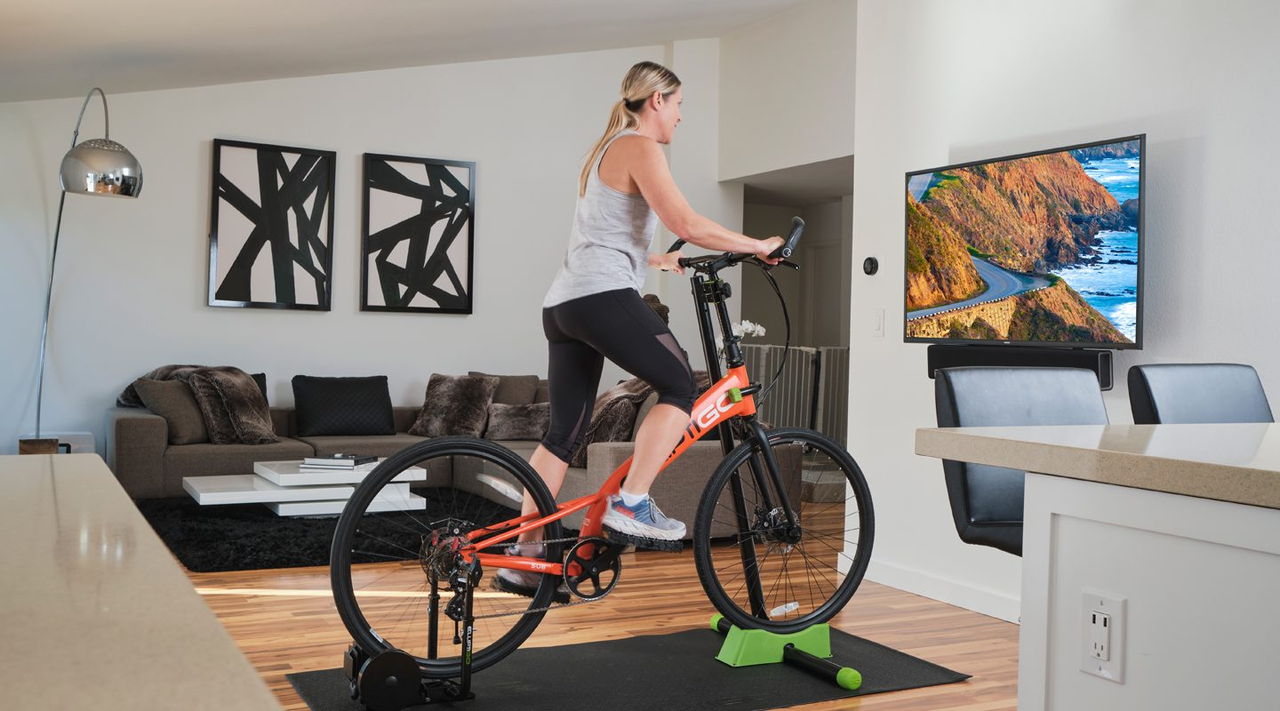 Woman indoor riding with Stationary Trainer